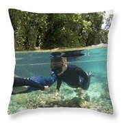 Split Level View Of Snorkeller Throw Pillow