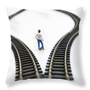 Figurine Between Two Tracks Leading Into Different Directions Symbolic Image For Making Decisions. Throw Pillow