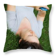 Woman Using Her Iphone Throw Pillow by Photo Researchers, Inc.