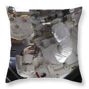 Astronaut Working On The International Throw Pillow