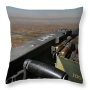 A .50 Caliber Machine Gun Points Throw Pillow by Stocktrek Images