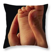 A Babys Foot In An Adult Hand Throw Pillow