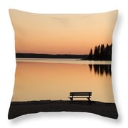 A Bench Silhouetted At Sunset Near The Throw Pillow