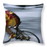 A Bicyclist Speeds Past In A Race Throw Pillow