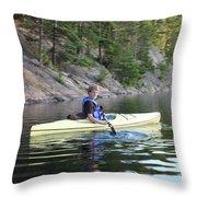 A Boy Kayaking Throw Pillow