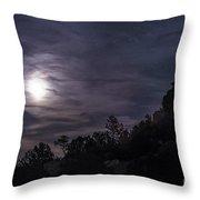 A Bright Moon Rises Through Clouds Throw Pillow