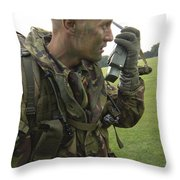 A British Army Soldier Radios Throw Pillow by Andrew Chittock