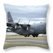 A C-130 Hercules Lands At Mcchord Air Throw Pillow