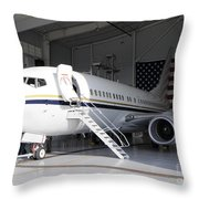A C-40 Clipper In A Hangar Throw Pillow
