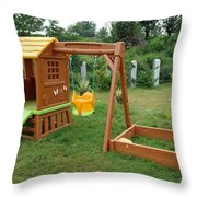 A Childs Playing Equipment In A Green Location Throw Pillow