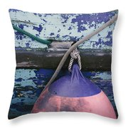 A Colorful Buoy Hangs From Ropes Throw Pillow