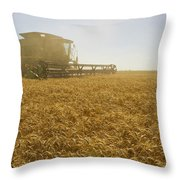 A Combine Harvester Works A Field Throw Pillow