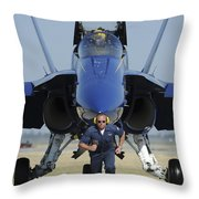 A Crew Chief Sprints Ahead Of A Blue Throw Pillow