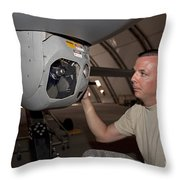 A Crew Chief Works On Mq-1 Predators Throw Pillow