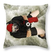 A Diver Is Hoisted Aboard An Sh-60f Throw Pillow
