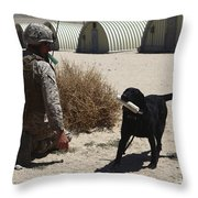 A Dog Handler Calls Over A Black Throw Pillow by Stocktrek Images