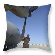 A Flight Engineer Performs A Pre-flight Throw Pillow