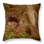 A Greenfinch At Its Nest Throw Pillow