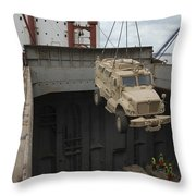 A Harbor Crane Lifts A Mine-resistant Throw Pillow