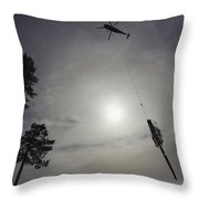 A Helicopter Lifts Cut Timber Throw Pillow
