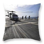 A Helicpter Sits On The Flight Deck Throw Pillow