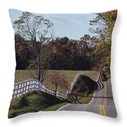 A Hilly Country Road Passes A Fenced Throw Pillow