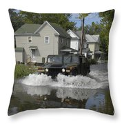 A Humvee Drives Through The Floodwaters Throw Pillow
