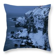 A Lighthouse Atop Snow-covered Cliffs Throw Pillow