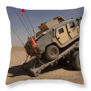 A M1114 Armored Vehicle Is Unloaded Throw Pillow