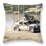A M1114 Humvee Patrols The Perimeter Throw Pillow