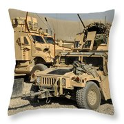 A M1114 Humvee Sits Parked In Front Throw Pillow