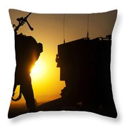 A Machine Gunner Prepares To Load An Throw Pillow