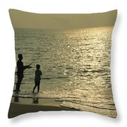 A Man And A Young Boy Fish In The Surf Throw Pillow