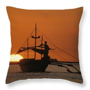 A Man And An Outrigger Silhouetted Throw Pillow
