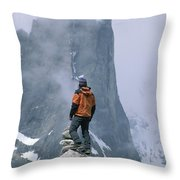 A Man Stands On A Cliff Watching Throw Pillow