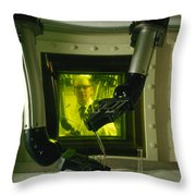 A Man Uses Mechanical Hands To Handle Throw Pillow