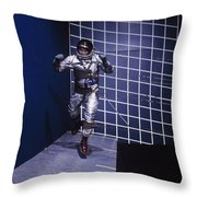 A Man Walks A Wall In A Special Harness Throw Pillow