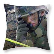 A Marine Communicates Over The Radio Throw Pillow
