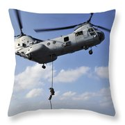 A Marine Fast Ropes From A Ch-46e Sea Throw Pillow