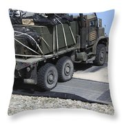 A Medium Tactical Vehicle Replenishment Throw Pillow