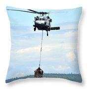 A Mh-60 Knighthawk Carries Supplies Throw Pillow