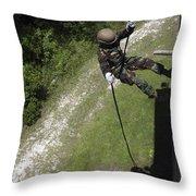 A Midshipman Rappels Down A Wall Throw Pillow
