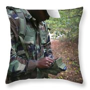 A Military Technician Uses A Pda Throw Pillow by Michael Wood