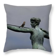A Mockingbird Sits Atop A Bronze Throw Pillow
