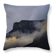 A Mountain Peaks Through The Clouds Throw Pillow