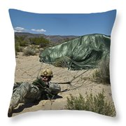 A Paratrooper Recovers After Landing Throw Pillow