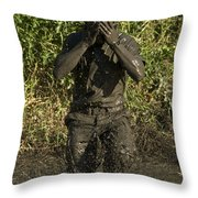 A Participant Wipes Mud From His Face Throw Pillow