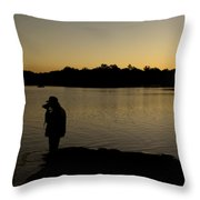 A Photographer At Work During Sunset Over A Lake Throw Pillow