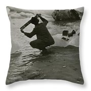 A Photographer Processes Film Among Ice Throw Pillow