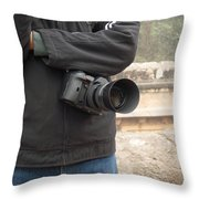 A Photographer With His Digital Camera On Location At A Historical Monument Throw Pillow